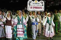 Spindulys dancers make their  entrance at  the XIII Lithuanian Folk Dance Festival - click to  enlarge